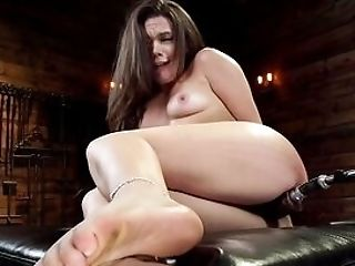 Dame Wiggles The Sex Machine Deep In Both Her Fuck Holes