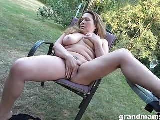 The Matures Using Her Thumbs To Finger Her Humid Vulva In The Garden