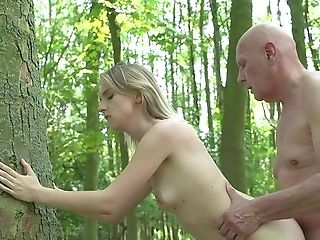 Youthful Blonde Leans Bootie For A Senior Fellow And Fucks In The Forest
