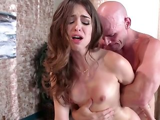 A Lovely Dark Haired Is Getting Fucked Hard By A Muscly Dude